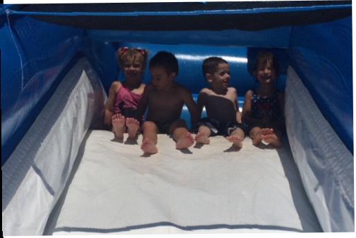 Happy kids on slide in kindergarten